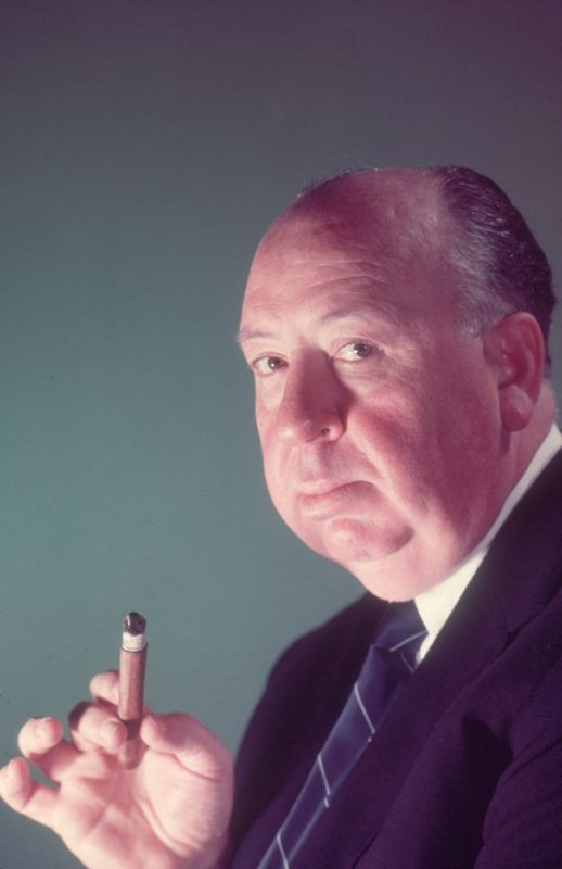 Alfred Hitchcock Holding A Cigar