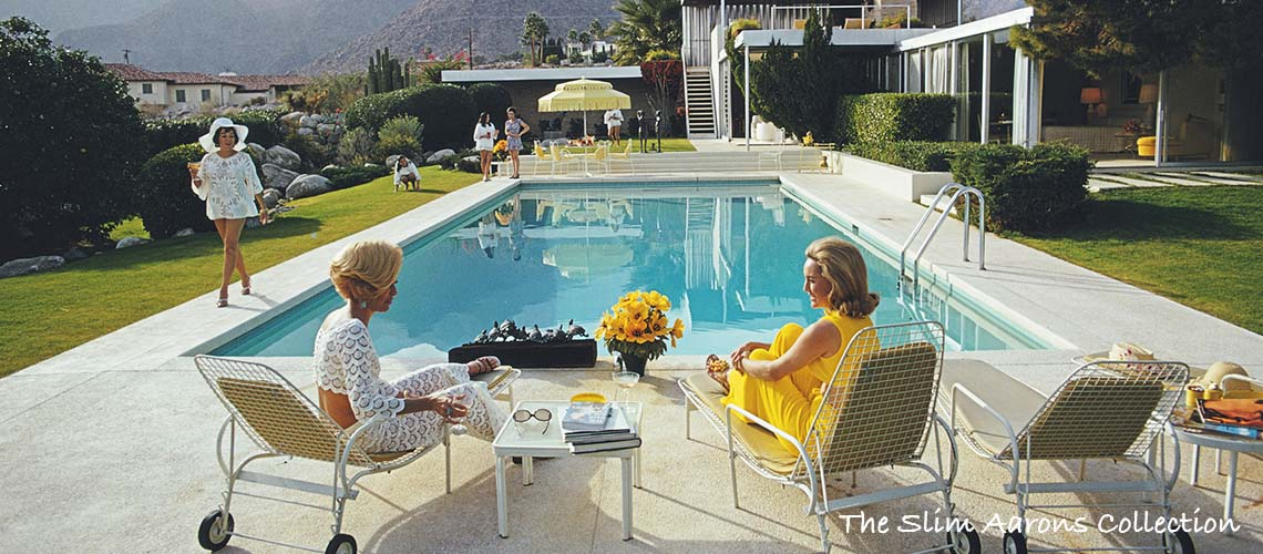 Note this image is available as an Open Edition only. Limited Edition is Sold Out. Please contact us directly to discuss. A desert house in Palm Springs designed by Richard Neutra for Edgar J. Kaufmann. Lita Baron approaches on the right Nelda Linsk, wife of art dealer Joseph Linsk who is talking to a friend, Helen Dzo Dzo. Original Artwork: A Wonderful Time – Slim Aarons (Photo by Slim Aarons)
