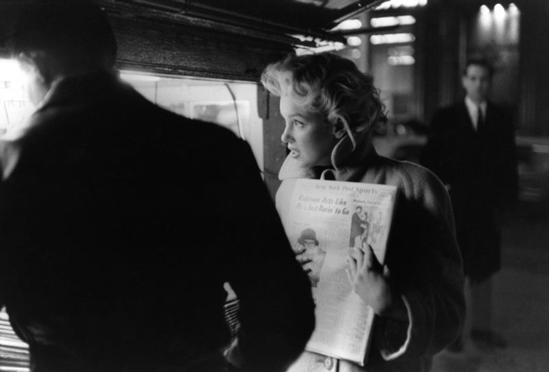 Marilyn Gets The Paper