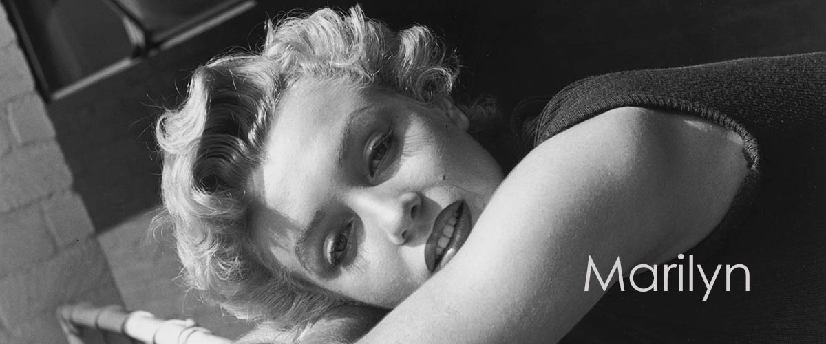 circa 1955: Portrait of American actor Marilyn Monroe (1926-1962) leaning her head over a railing and wearing a sleeveless sweater. (Photo by Hulton Archive)